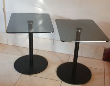 Pair contemporary smoked glass and metal pedestal occasional tables, the rectangular tops with