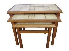 20th century nest of three tile-top tables in beige, 64cm wide
