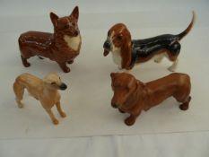 Beswick modelof a corgi, a Beswick model of a bassett hound, adachshundand a lurcher(4)