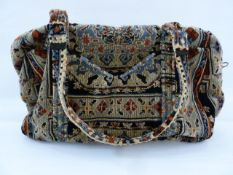 Cut velvet tapestry bag labelled Carpet Bags with zip fastening and double-handled strap with