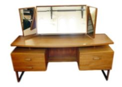 1967 G-Plan bed teak bedroom suite comprising three-door wardrobe with two sliding and one opening