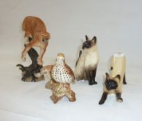 Model of a Siamese cat, anotherseated, a Beswick modelof a Thrush, a 'The Defender' hand-painted