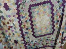 Mid twentieth century patchwork quilt, back with mauve satin, 249 x 237 cms approx. some patches