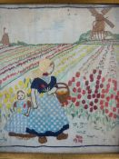 Early 20th century embroidery depicting mother and child among tulip field, with windmill in