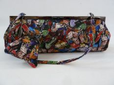 Philip Treacy silk handbag printed with butterflies, attached purse, fabric handle and original dust