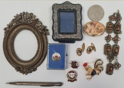 Silver cased propelling pencil, a brass picture frame of oval form with cold painted flowers, a