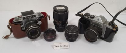 Exa camerawith Meyer Optic lens, a mini Rexina projector, a Photax-Paragon 1:2.8 camera lensand