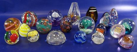 Assorted glass paperweightsto include Caithness 'Cauldron', Caithness 'Pebble', Caithness '