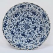 17th/18th century large Delft dishdecorated with stylised flowers and leaves, 40cm diameter (with