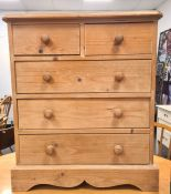 20th century pine chest of two short over three long drawers, on plinth base, 66W x 76H x 35.5D cm