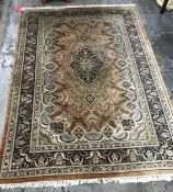 A Persian style rug central medallion foliate decoration borders  in dark brown and green, 213 x