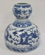 Chinese porcelain double-gourd vasewith broad flat base and underglaze blue decoration of dragons