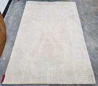 A modern cream ground rug with stylised rectangular design,238 x 156cm
