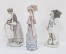 Lladro figure of a lady with parasol, 26cm high, a Lladro figureof a young girl with ducks and