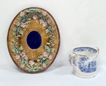 Victorian majolica oval dishdecorated with rose branches in relief, on a rustic ground, unmarked,