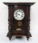 20th century Vienna regulator style clock with Roman numerals to the ceramic dial