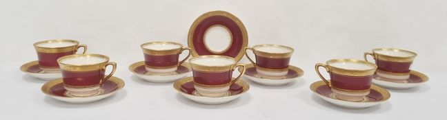 Set of seven Royal Worcester 'Diana' pattern coffee cups and eight saucers, maroon ground with