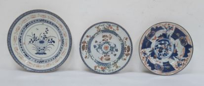 Three various Chinese porcelain plates, variously decorated in principally iron-red and blue, with