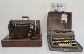 Royal De-Luxe portable typewriter in carrying case and with instructions and a Singer sewing machine