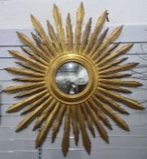 Large modern sunburst mirror, the central circular mirror approximately 28cm diameter, overall
