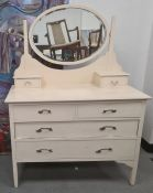 Cream painted dressing chest, the oval mirror above two short and two long drawers, on square