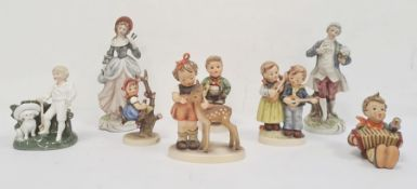 Five Hummel / Goebel figures of children, and three further continental china figures (8)Condition