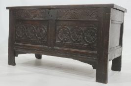 Possibly 18th century oak coffer having triple framed panel top, lunette carved frieze, the two