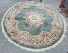 Modern Chinese superwash rug, the green ground with central medallion, stepped border decorated with