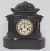 Black slate mantel clock with Roman numerals to the dial