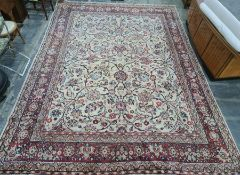 Cream ground Eastern-style rug with allover foliate design, red ground and stepped border, 400cm x