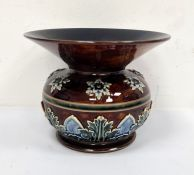 Doulton Lambeth spittoon vaseof circular form with flared rim, decorated with stylised leaves and