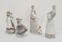 Lladro figureof a girl with kittens, a Lladro figure of a girl with goose and puppy, a Lladro