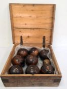 Set of eight early 20th century wooden lawn bowlswith bone marking dots and a smaller turned wooden