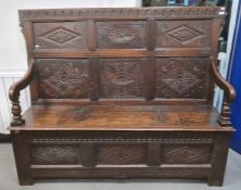 19th century oak bench with carved panelled back, lift-top box seat, fronted by three diamond carved