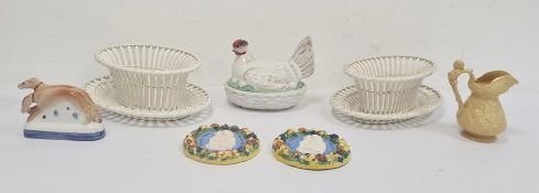 Flatback-type figure of a pair of greyhounds, a pair of Creil creamware oval basketson trays, a