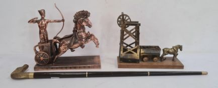 Copper model of an Egyptian chariot rider and a brass model of a pit pony and winch and a walking