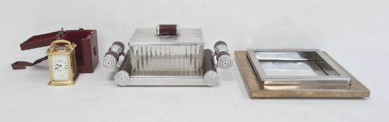 Chrome bakelite and pressed glass cigarette box of Art Deco design on mirrored two handled base, a