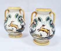 Pair of two-handled pottery vases, probably Italian, decorated with deer and trees within yellow