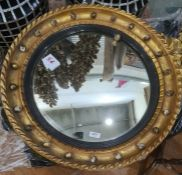 Possibly late 19th century circular mirror with slightly convex glass, the frame surmounted by