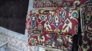 Heavily cut down rug, the red ground with allover foliate pattern, with alterations, notches, cut,
