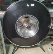 Large vintage circular, black and silver coloured metal , electric heater
