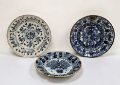 Antique circular blue and white Delft charger, floral decorated (repaired), marked B:P to base, 35cm