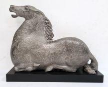 Silvered plaster modelof a kneeling horse, on rectangular plinth, 40cm high