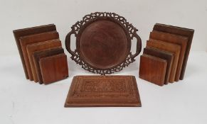Pair of wooden bookends modelled as books of descending height, a carved wooden two-handled trayand