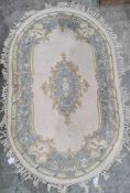 Chinese oval rug, cream ground with blue decoration