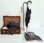 Leather suitcase and contents including vintage handbags, an umbrella and a box of textiles