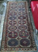 Eastern runner with two rows of nine medallions, in blues, reds and whites, 278cm x 123cm