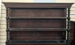 Victorian carved oak three-tier platerackhaving carved lunette frieze, on bulbous ring turned
