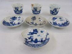 Three, probably 18th century, Chinese porcelain beakers of inverse bell shape, underglaze blue