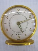 Jaeger8-day travelling alarm clock, the circular dial with numerals and baton markers, hand